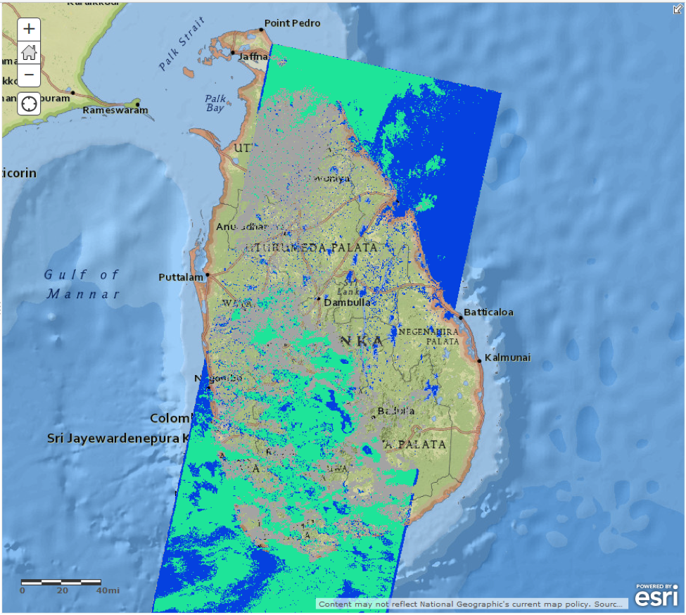 Flood extent map over Sri Lanka from Landsat-8 data.  Open water (including oceans) is blue, clouds with open water believed to be underneath are green, and areas completely obscured by clouds are grey.
